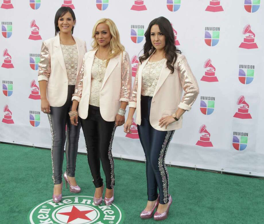 Mexican music group Trio Ellas arrives for the 13th Annual Latin Grammy Awards on November 15, 2012 in Las Vegas, Nevada.    AFP PHOTO/John GURZINSKIJOHN GURZINSKI/AFP/Getty Images Photo: JOHN GURZINSKI, Getty Images / AFP