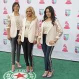 Mexican music group Trio Ellas arrives for the 13th Annual Latin Grammy Awards on November 15, 2012 in Las Vegas, Nevada.    AFP PHOTO/John GURZINSKIJOHN GURZINSKI/AFP/Getty Images
