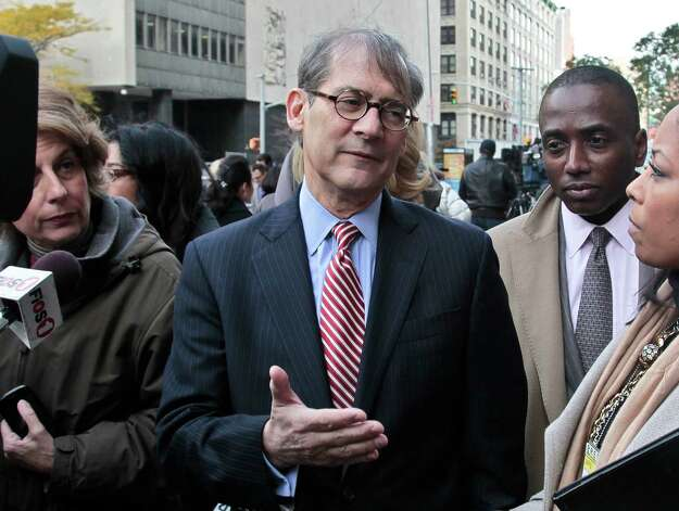 Robert Gottlieb, center, lawyer for the family of Pedro Hernandez, who is charged with 1979 killing of Etan Patz, speaks during a news conference outside court on Thursday, Nov. 15, 2012 in New York.   Hernandez was in court for a brief proceeding and ordered held without bail until his next court date set for Dec. 12.  (AP Photo/Bebeto Matthews) Photo: Bebeto Matthews