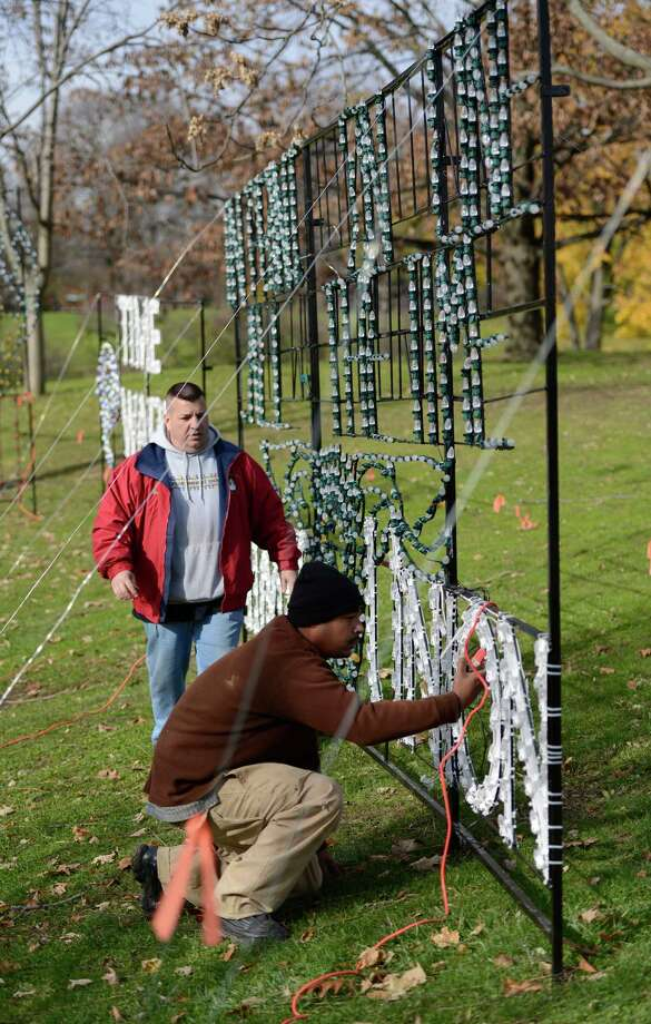 Tomar Fantroy, setup supervisor, foreground, works with Dave Rose, vice chairman of Albany PAL as they make final preparations for the opening night of the 16th Annual Price Chopper Capital Holiday Lights in Washington Park in Albany, N.Y. Nov 15, 2012.  The show officially opens the evening of November 26th and runs thru January 2, 2013.     (Skip Dickstein/Times Union) Photo: Skip Dickstein / 00020111A