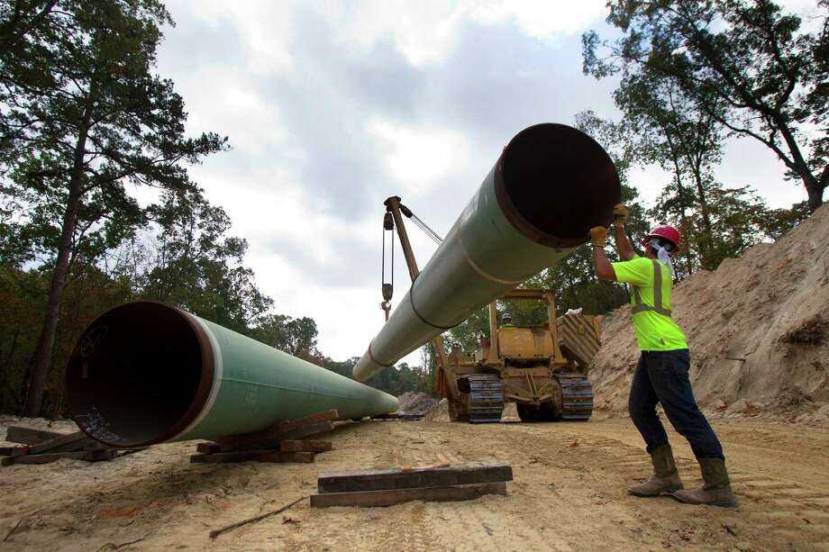 Work proceeds in Texas last year on the U.S. part of the Keystone XL. The portion crossing from Canada awaits approval. Photo: Cody Duty, Staff / Houston Chronicle