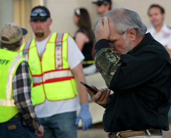 """Show of Support"" president and founder Terry Johnson talks on the phone following a fatal accident where a semi trailer carrying veterans in the Hunt for Heroes parade was struck by a train in Midland, Texas, Thursday, Nov. 15, 2012. Johnson tells the Midland Reporter-Telegram that there are ""multiple, multiple"" injuries and organizers still are trying to account for everyone. (AP Photo/Reporter-Telegram, Tim Fischer) Photo: Tim Fischer, Associated Press / Reporter-Telegram"