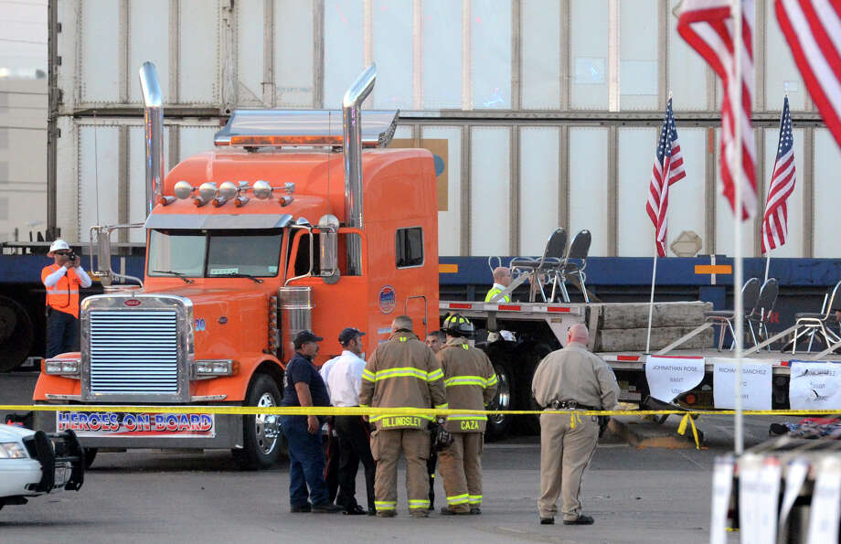 "Midland police, fire and sheriffs respond to an accident where a trailer carrying wounded veterans in a parade was struck by a train in Midland, Texas, Thursday, Nov. 15, 2012. ""Show of Support"" president and founder Terry Johnson tells the Midland Reporter-Telegram that there are ""multiple, multiple"" injuries and organizers still are trying to account for everyone. (AP Photo/Reporter-Telegram, James Durbin) Photo: James Durbin, Associated Press / Reporter-Telegram"