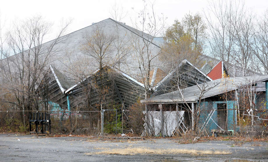 Demolition begins on the Starlite Theater on Thursday, Nov. 15, 2012 in Latham, N.Y. The developer is planning to build a mixed group of buildings with residential, office and retail space. (Lori Van Buren / Times Union) Photo: Lori Van Buren