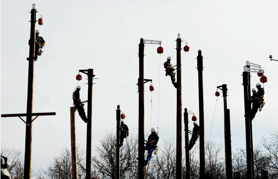 "Students in the National Grid training program get their third day of class up in the air on poles as they begin a 5 1/2 year process of becoming a ""hot stick"" or journeyman lineman at the training facility in Schenectady, N.Y. Nov 15, 2012.       (Skip Dickstein/Times Union) Photo: Skip Dickstein / 00020149A"