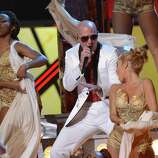 Pitbull performs during the 13th Annual Latin Grammy show on November 15, 2012 in Las Vegas, Nevada.    AFP PHOTO/Robyn BECKROBYN BECK/AFP/Getty Images