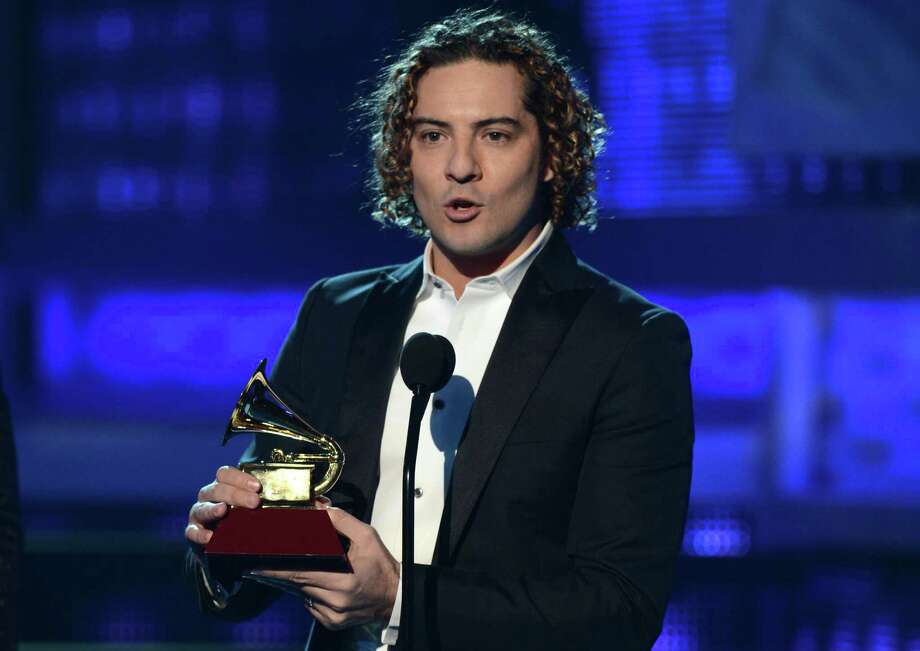 David Bisbal accepts his award during the 13th Annual Latin Grammy show on November 15, 2012 in Las Vegas, Nevada.    AFP PHOTO/Robyn BECKROBYN BECK/AFP/Getty Images Photo: ROBYN BECK, Getty Images / AFP
