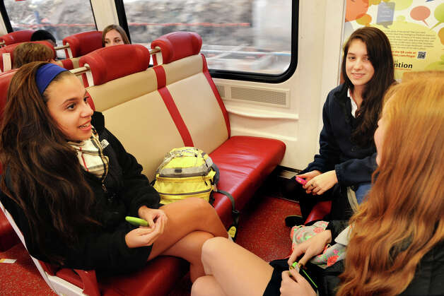 (From left), Emma San Filippo, of Stamford, Isabelle Smith, of Fairfield, and Nicole Grabe, of Fairfield, all sophomores at Lauralton Hall Catholic High School in Milford, talk as they ride one of the new M-8 Metro North trains home from school, Nov. 15th, 2012. The girls said they like the new trains. Photo: Ned Gerard / Connecticut Post