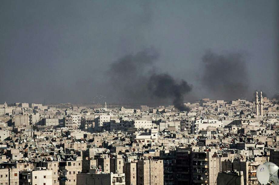 In this Wednesday, Nov. 14, 2012 photo, smoke rises after a Syrian mortar shell landed in a neighborhood in Aleppo, Syria.(AP Photo/Narciso Contreras). Photo: Narciso Contreras