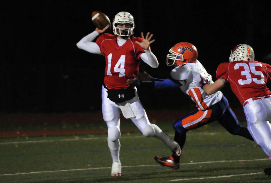 Greenwich QB  Liam O'Neil throws as Danbury's Marlon Black moves in to tackle as Greenwich High School hosts Danbury in a football game in Greenwich, Conn., Nov. 15, 2012. Photo: Keelin Daly / Stamford Advocate Riverbend Stamford, CT