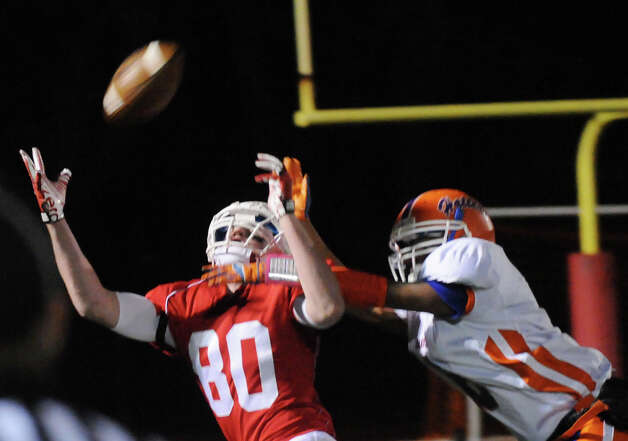 Greenwich's Joe Kelly receives as Danbury's Alfred Valentine tackles as Greenwich High School hosts Danbury in a football game in Greenwich, Conn., Nov. 15, 2012. Photo: Keelin Daly / Stamford Advocate Riverbend Stamford, CT