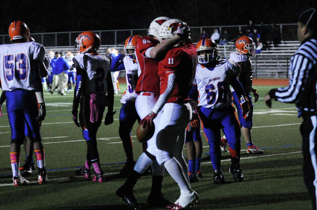 Greenwich's Joe Kelly, left, congratulates Alex McMurray after a touchdown as Greenwich High School hosts Danbury in a football game in Greenwich, Conn., Nov. 15, 2012. Photo: Keelin Daly / Stamford Advocate Riverbend Stamford, CT