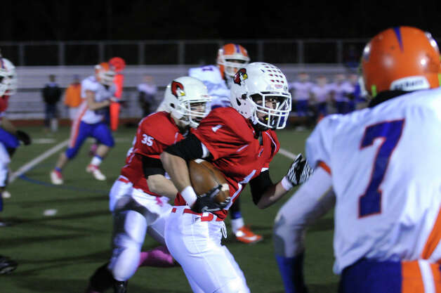 Greenwich's Vincent Ferraro moves the ball as Greenwich High School hosts Danbury in a football game in Greenwich, Conn., Nov. 15, 2012. Photo: Keelin Daly / Stamford Advocate Riverbend Stamford, CT