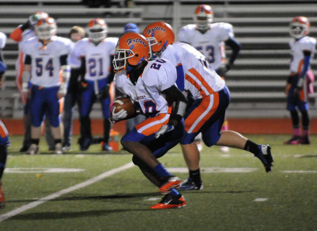 Danbury's Akim Moffitt in action as Greenwich High School hosts Danbury in a football game in Greenwich, Conn., Nov. 15, 2012. Photo: Keelin Daly / Stamford Advocate Riverbend Stamford, CT