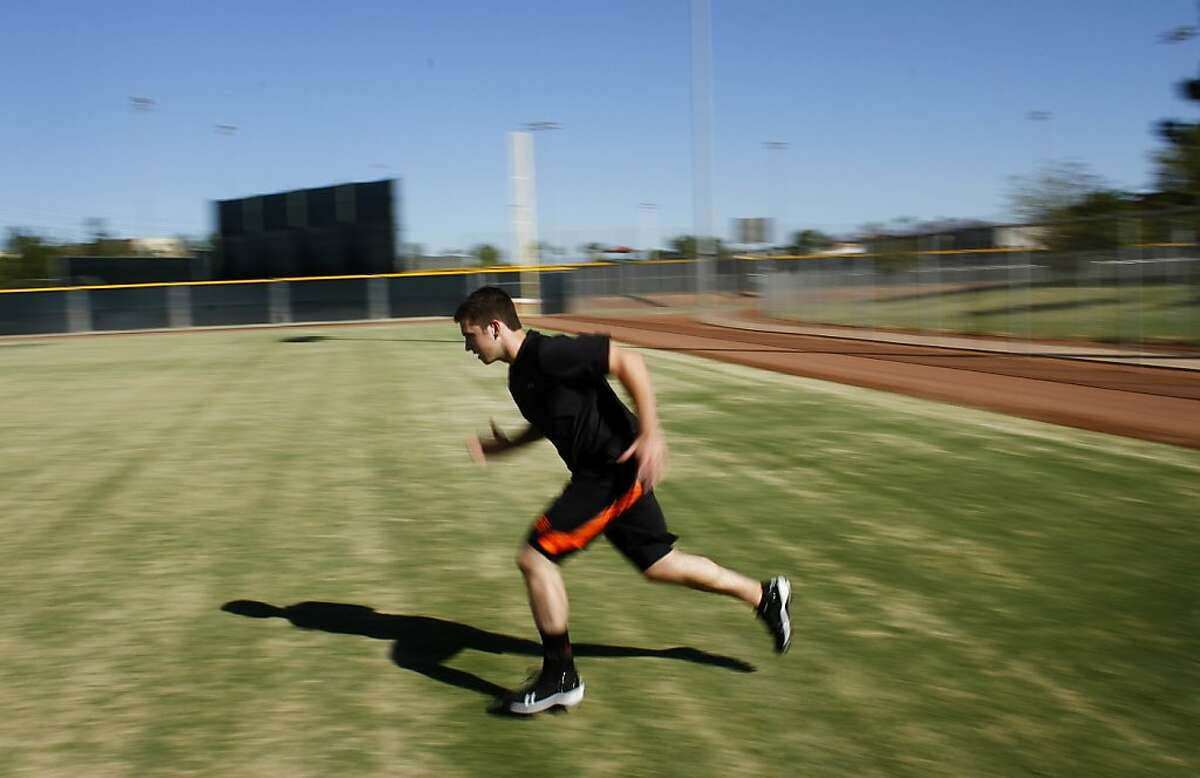 San Francisco Giants catcher Buster Posey runs sprints during a workout at the Giants training facility in Scottsdale, Arizona October 28, 2011. Posey is recovering from a broken left ankle after colliding with Florida Marlins Scott Cousins during a play at home plate in May. The Giants are expecting Posey to start during the 2012 baseball season. Photo for the San Francisco Chronicle by Joshua Lott