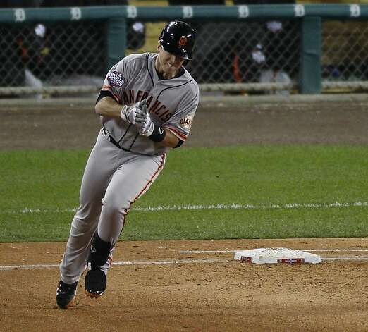 Giants' catcher Buster Posey reacts to his 2-run homer in the 6th inning during the World Series game 4 at Comerica Park in Detroit, MI, on Sunday, Oct. 28, 2012. Photo: Carlos Avila Gonzalez, The Chronicle