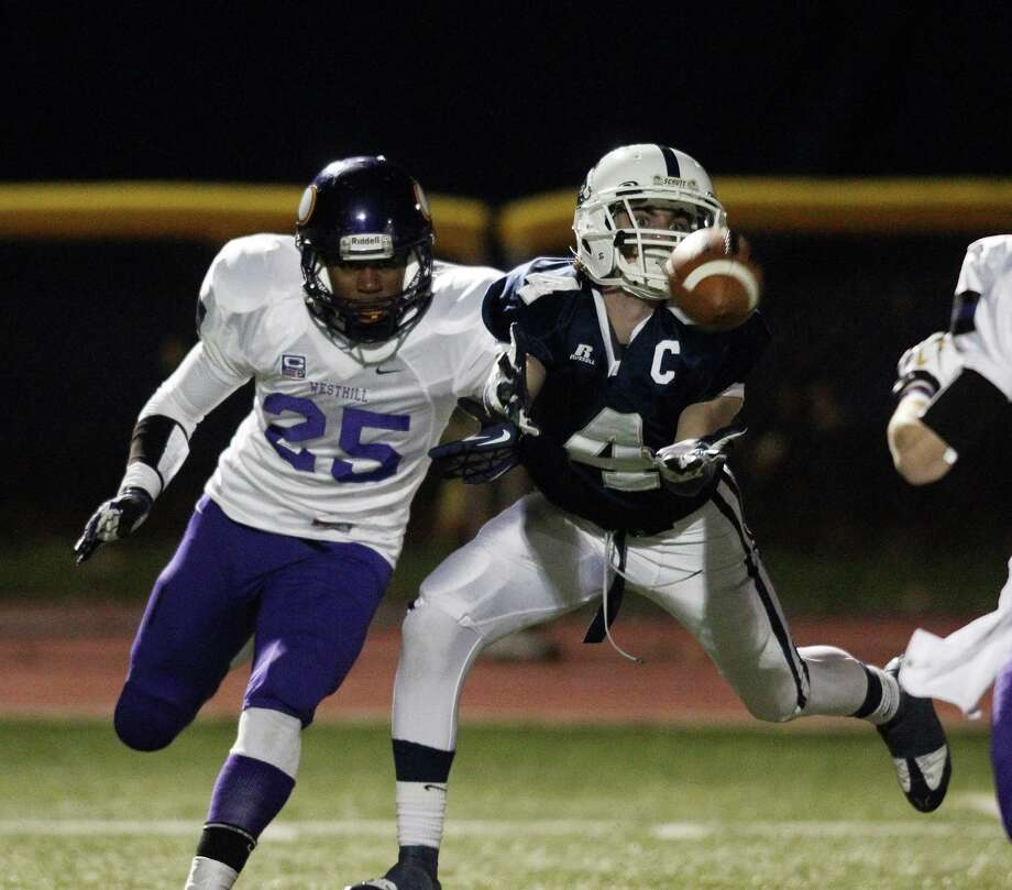 Staples wide freceiver James Frusciante narrowly misses catching a long bomb tossed his way in second quarter action against Westhill. Defending on the play is Westhill's Yveson Cassamajor. Photo: J. Gregory Raymond / Stamford Advocate Freelance;  © J. Gregory Raymond