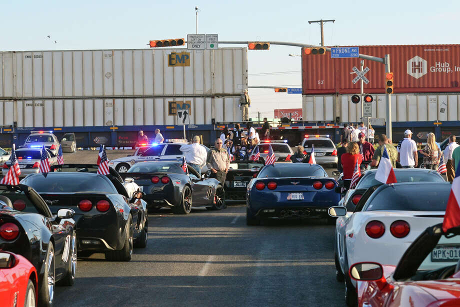Parade participants look on after a trailer carrying wounded veterans in a parade was struck by a train in Midland, Texas, Thursday, Nov. 15, 2012. Photo: James Durbin, Associated Press / Reporter-Telegram