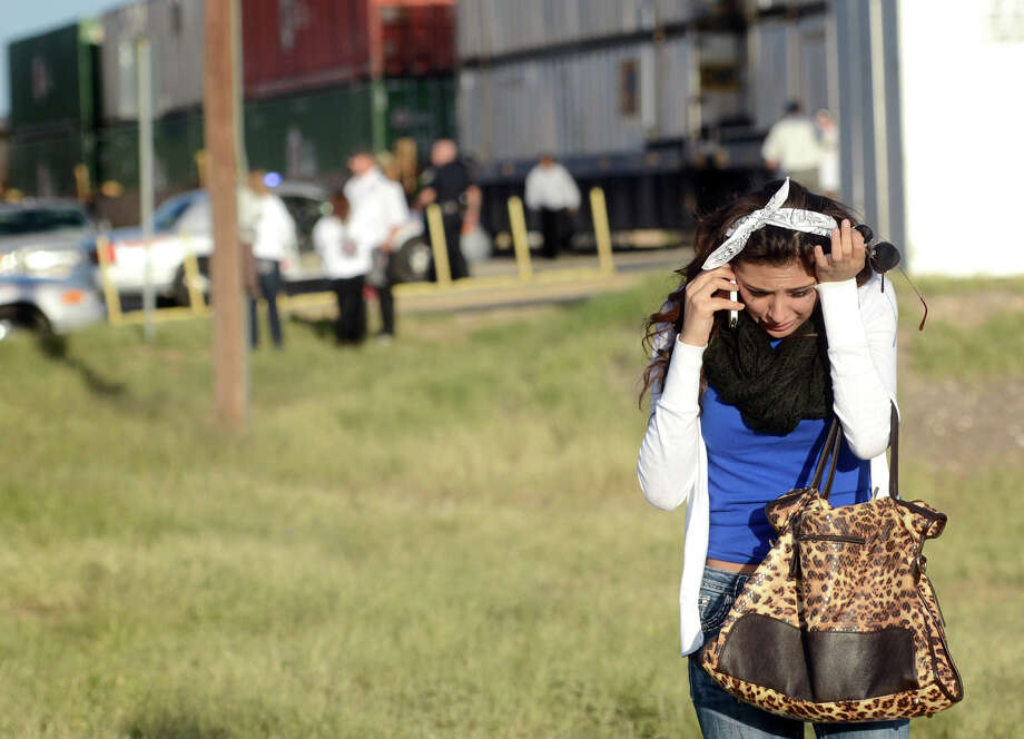 A parade participants reacts after a trailer carrying wounded veterans in a parade was struck by a train in Midland, Texas, Thursday, Nov. 15, 2012. Photo: James Durbin, Associated Press / Reporter-Telegram