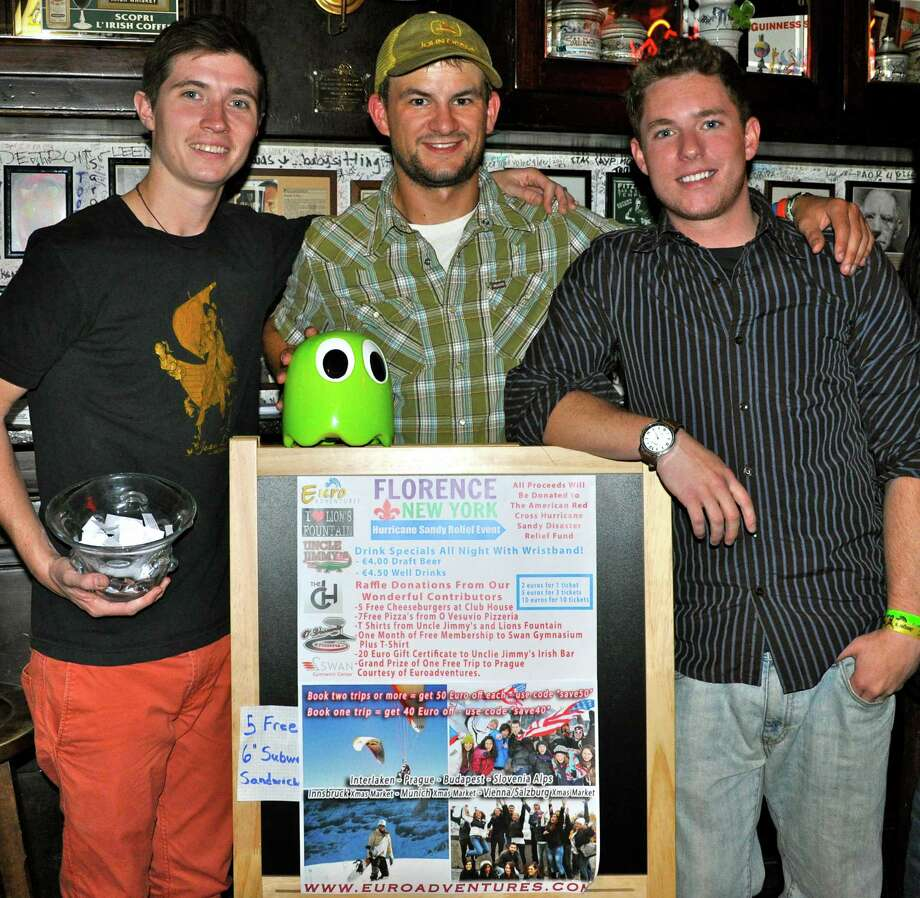(submitted by Dylan Welch) From left, Timothy Frankie, Tony Berringer and Dylan Welch, all Bethlehem natives and staff of the international student-based travel company Euroadventures, organized an event in Florence, Italy, on Nov. 7 that raised $553 to help hurricane victims. The men said there are thousands of students studying abroad in Italy, many of whom were forced to watch as the storm demolished the homes they grew up in and the towns they loved.