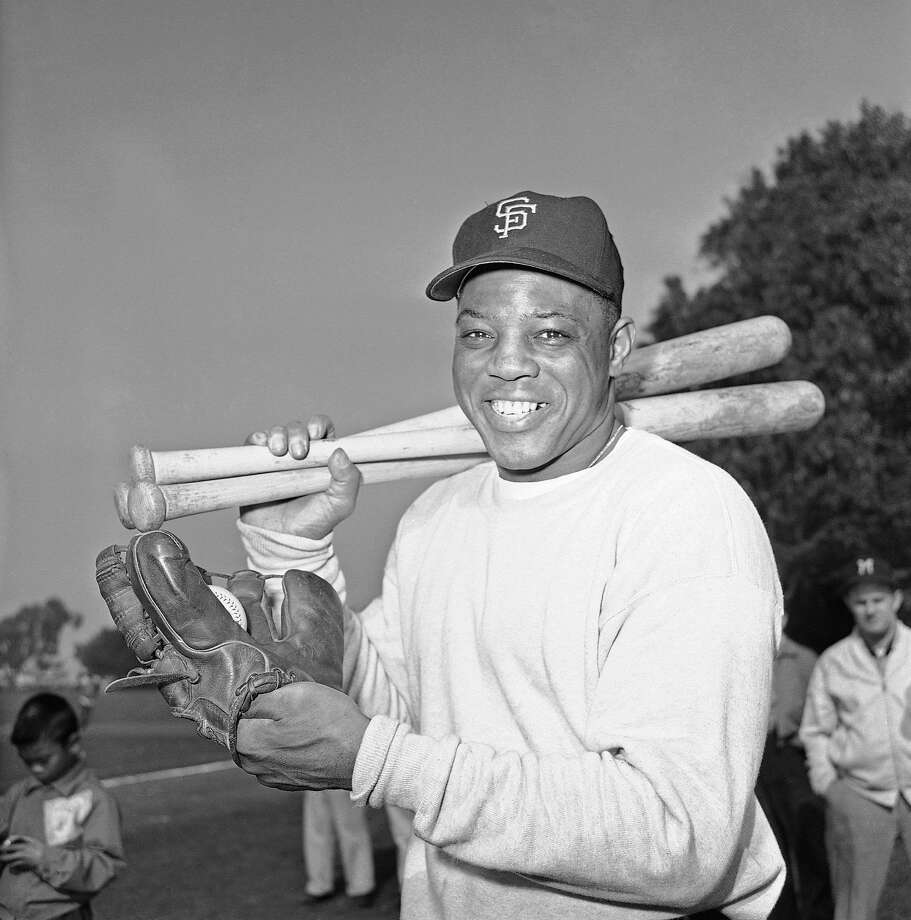 Willie Mays, star outfielder for the San Francisco Giants, arrives on Feb. 4, 1962 at a San Francisco public playground equipped for a workout on his own.   Mays, who recently signed a Giants contract for an estimated $90,000 largest in Giants  history, said he wanted to limber up some as spring training is just around the corner. (AP Photo/Robert Houston) Photo: Robert Houston, ASSOCIATED PRESS