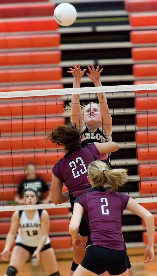 Joel Barlow high school's Hannah Goetz goes up to block the ball in a CIAC class L semifinal girls volleyball tournament game against East Lyme high school played at Shelton high school, Shelton, CT on Thursday November 15th, 2012 Photo: Mark Conrad / Connecticut Post Freelance
