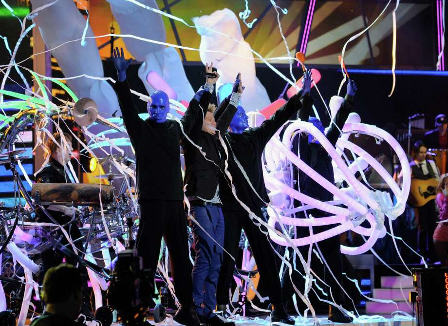 Singer Michel Telo (C) and Blue Man Group perform onstage during the 13th annual Latin GRAMMY Awards held at the Mandalay Bay Events Center on November 15, 2012 in Las Vegas, Nevada. Photo: Kevork Djansezian, Getty Images / 2012 Getty Images