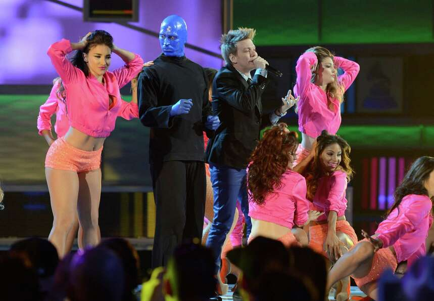 Singer Michel Telo and Blue Man Group perform onstage during the 13th annual Latin GRAMMY Awards hel