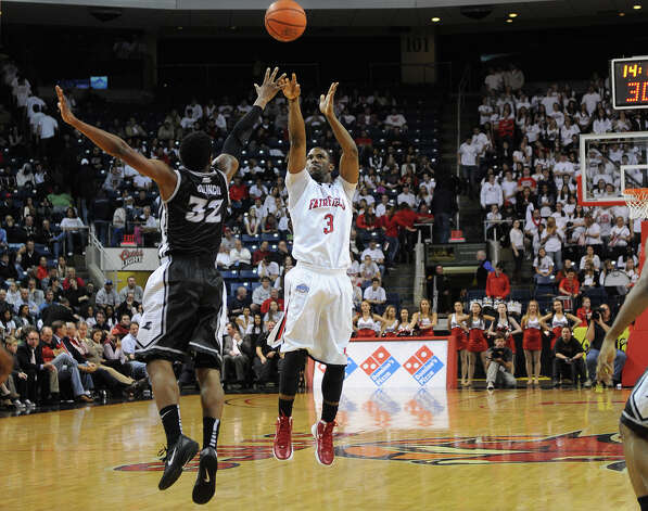 Fairfield's Derek Needham shoots a jumper over Providence defender Vincent Council during their matchup at the Webster Bank Arena in Bridgeport on Monday, November 14, 2011. Photo: Brian A. Pounds / Connecticut Post