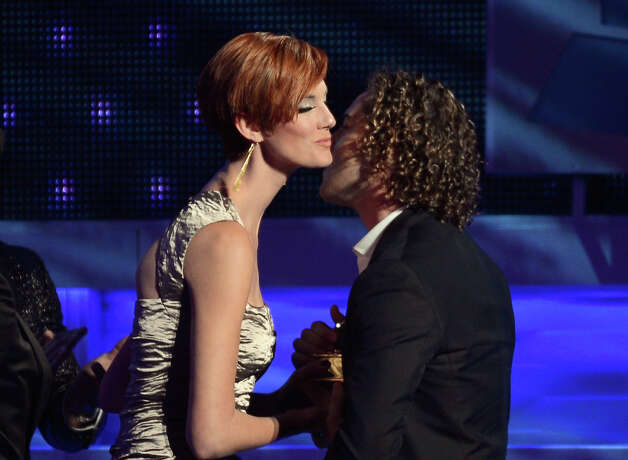Singer David Bisbal (R) accepts the award for Best Pop Traditional Vocal Album from presenter Deborah de Corral onstage during the 13th annual Latin GRAMMY Awards held at the Mandalay Bay Events Center on November 15, 2012 in Las Vegas, Nevada. Photo: Kevork Djansezian, Getty Images / 2012 Getty Images