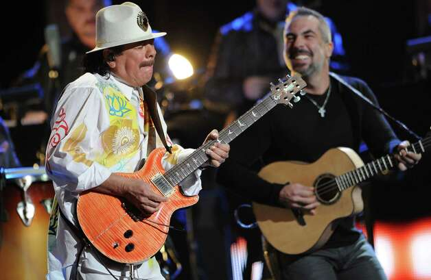"Santana, left, performs ""Fijate Bien"" at the 13th Annual Latin Grammy Awards at Mandalay Bay on Thursday, Nov. 15, 2012, in Las Vegas. (Photo by Al Powers/Powers Imagery/Invision/AP) Photo: Al Powers, Associated Press / Invision"