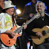 """Santana, left, performs """"Fijate Bien"""" at the 13th Annual Latin Grammy Awards at Mandalay Bay on Thursday, Nov. 15, 2012, in Las Vegas. (Photo by Al Powers/Powers Imagery/Invision/AP)"""