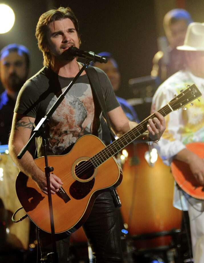 "Juanes performs ""Fijate Bien"" at the 13th Annual Latin Grammy Awards at Mandalay Bay on Thursday, Nov. 15, 2012, in Las Vegas. (Photo by Al Powers/Powers Imagery/Invision/AP) Photo: Al Powers, Associated Press / Invision"