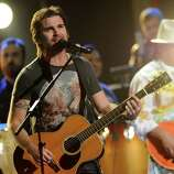 """Juanes performs """"Fijate Bien"""" at the 13th Annual Latin Grammy Awards at Mandalay Bay on Thursday, Nov. 15, 2012, in Las Vegas. (Photo by Al Powers/Powers Imagery/Invision/AP)"""