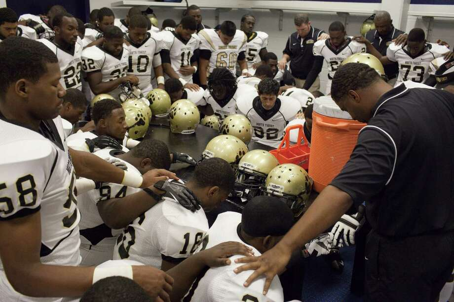 North Forest ISD football players pray before playing Wheatley High School Nov. 10, 2012 in Houston at Barnett Stadium. North Forest leaders are fighting to keep the state from closing their school district next year unless they can raise student test scores, lower the dropout rate, repay $8 million in debt and don't deplete the savings account again. Photo: Eric Kayne, For The Chronicle / © 2012 Eric Kayne