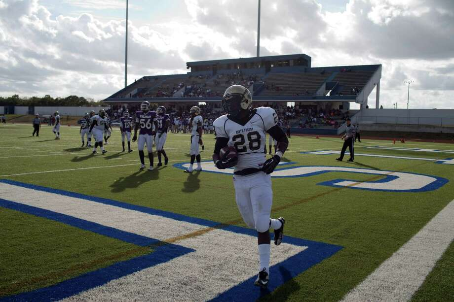 North Forest ISD football player Alex Benjamin scores a touchdown as his team plays Wheatley High School Nov. 10, 2012 in Houston at Barnett Stadium. North Forest won and is now 10-0 - they won 4 games last season and just two the year before that. North Forest leaders are fighting to keep the state from closing their school district next year unless they can raise student test scores, lower the dropout rate, repay $8 million in debt and don't deplete the savings account again. Photo: Eric Kayne, For The Chronicle / © 2012 Eric Kayne