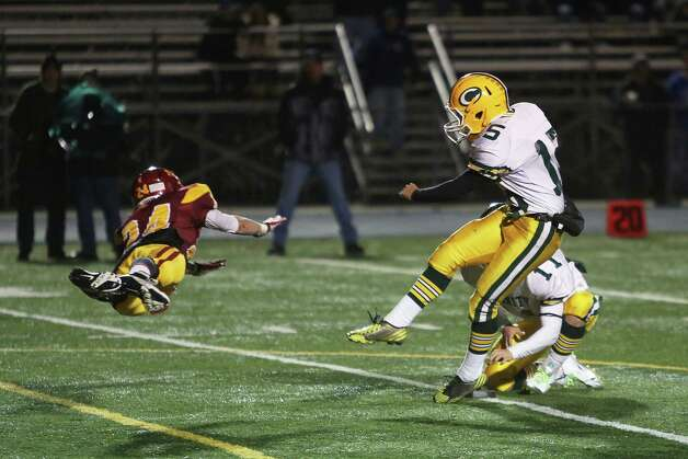Mike Ross Connecticut Post freelance -St. Joseph's #24 Jon Prutting makes an attempt to block the kick from Trinity Catholic High School's kicker #15 John Benalcazar during first half action on Thursday evening. Photo: Mike Ross / Connecticut Post Freelance