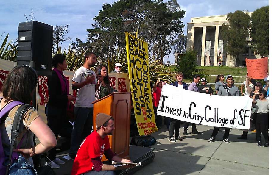 Students and faculty members hold a rally at City College of San Francisco to protest plans to consolidate departments in a move officials say is needed to save the school's accreditation. Photo: Nanette Asimov, The Chronicle