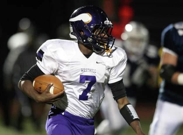 Westhill running back Davell Cotterell eyes the field en route to a 60 plus touchdown yard run in football action against Staples Thursday evening. Photo: J. Gregory Raymond / Stamford Advocate Freelance;  © J. Gregory Raymond