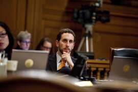 Supervisor Scott Weiner listens to members of the public speak during the ethics hearing for Mirkarimi at City Hall in San Francisco, Calif., Tuesday, October 9, 2012.