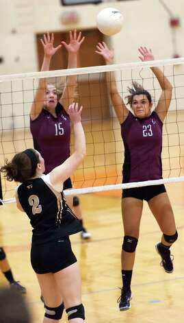 East Lyme high school's Jenna Schumacher and Kara Seitz go up to block the ball at the net in a CIAC class L semifinal girls volleyball tournament game against  Joel Barlow high school played at Shelton high school, Shelton, CT on Thursday November 15th, 2012 Photo: Mark Conrad / Connecticut Post Freelance