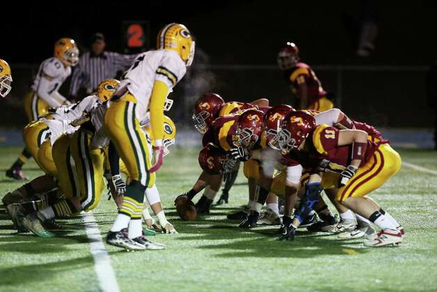 Mike Ross Connecticut Post freelance -St. Joseph's offense take on Trinity Catholic High School defense on the goalline during first half action on Thursday evening. St. Joseph's would score a touchdown on the play. Photo: Mike Ross / Connecticut Post Freelance