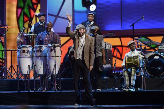 Singer Juan Luis Guerra performs onstage during the 13th annual Latin GRAMMY Awards held at the Mandalay Bay Events Center on November 15, 2012 in Las Vegas, Nevada. Photo: Kevork Djansezian, Getty Images / 2012 Getty Images