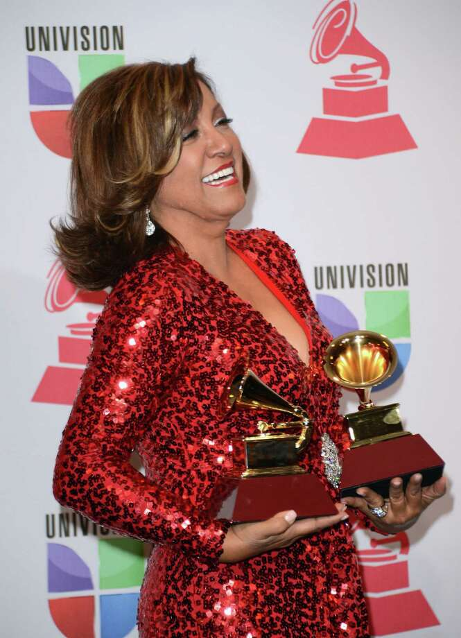 Singer Milly Quezada poses with the award for Best Contemporary Tropical Album in the press room during the 13th annual Latin GRAMMY Awards held at the Mandalay Bay Events Center  on November 15, 2012 in Las Vegas, Nevada. Photo: Jason Merritt, Getty Images / 2012 Getty Images