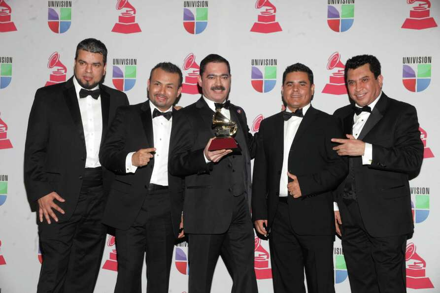 Los Tucanes de Tijuana pose with the trophy for Best Norteno Album at the 13th Annual Latin Grammy A