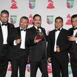 Los Tucanes de Tijuana pose with the trophy for Best Norteno Album at the 13th Annual Latin Grammy Awards on November 15, 2012 in Las Vegas, Nevada.    AFP PHOTO/John GURZINSKIJOHN GURZINSKI/AFP/Getty Images
