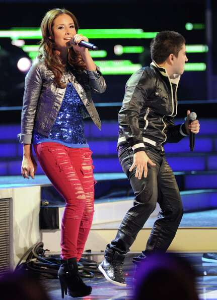 America Sierra, left, and El Bebeto perform at the 13th Annual Latin Grammy Awards at Mandalay Bay o