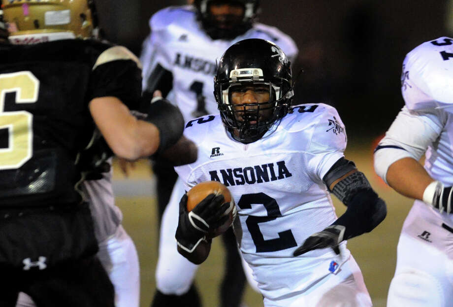 Ansonia's #2 Arkeel Newsome carries the ball, during NVL football championship action action against Woodland in Waterbury, Conn. on Thursday November 14, 2012. Photo: Christian Abraham / Connecticut Post