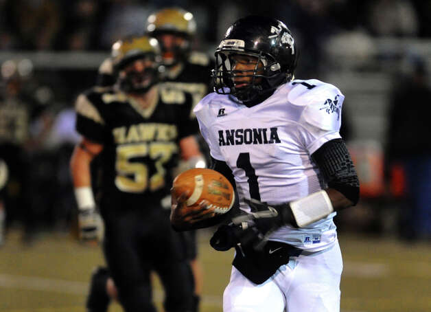 Ansonia's #1 Jaiquan McKnight carries the ball, during NVL football championship action action against Woodland in Waterbury, Conn. on Thursday November 14, 2012. Photo: Christian Abraham / Connecticut Post