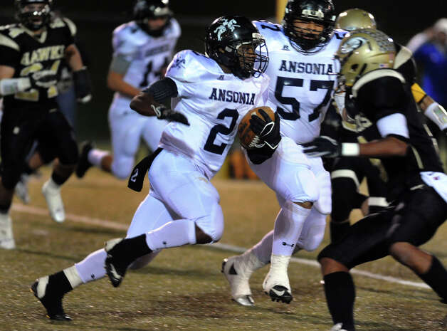 Ansonia's #2 Arkeel Newsome makes his way to the endzone for a touchdown, during NVL football championship action action against Woodland in Waterbury, Conn. on Thursday November 14, 2012. Photo: Christian Abraham / Connecticut Post